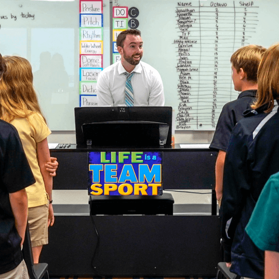 Mr. Nelson teaching choir